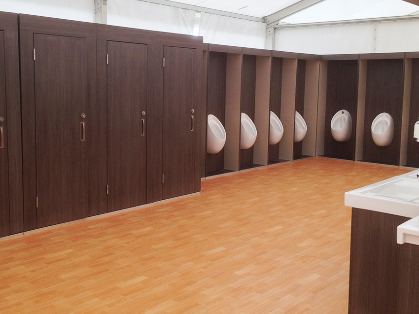 Row of Flexiloo cubicles and urinals