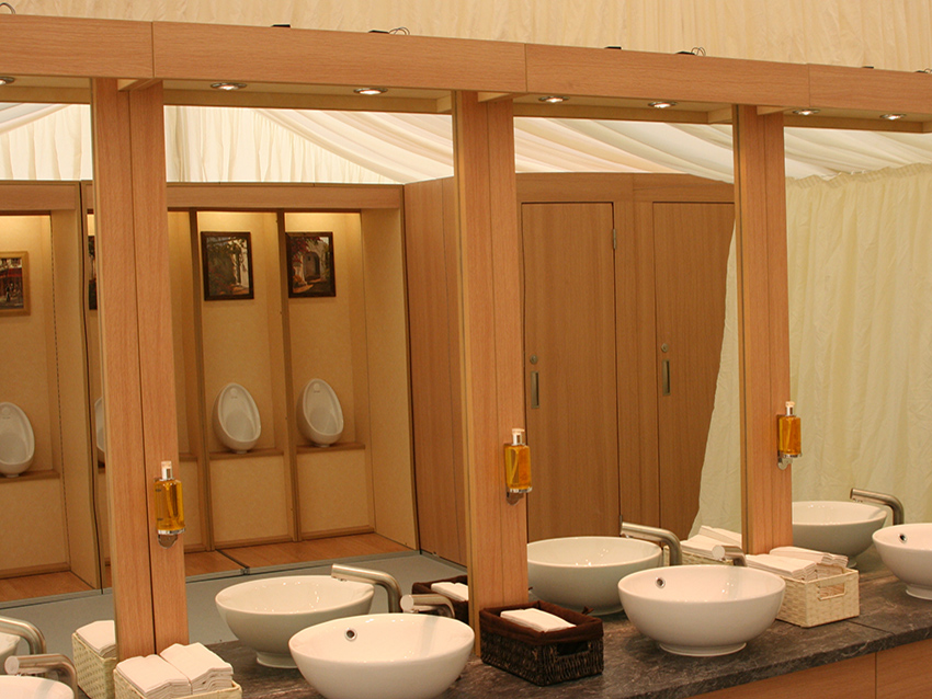 Mirror view of Flexiloo sinks and urinals